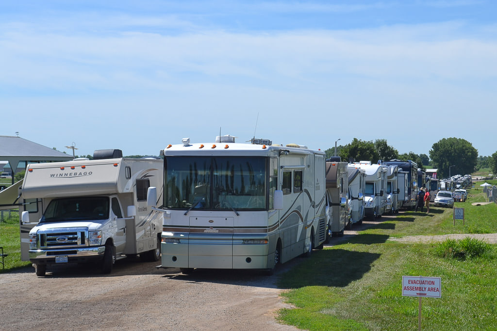 Winnebago motorhomes lined up preparing to enter the rally grounds