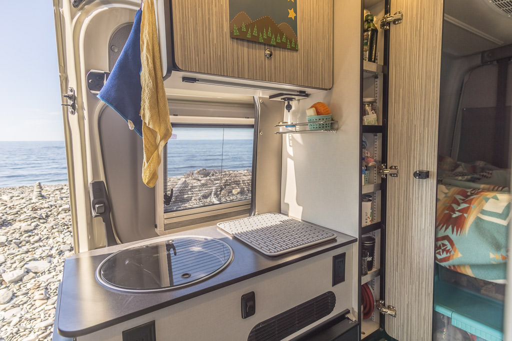 Detail view of Winnebago Galley and added homemade pantry shelves