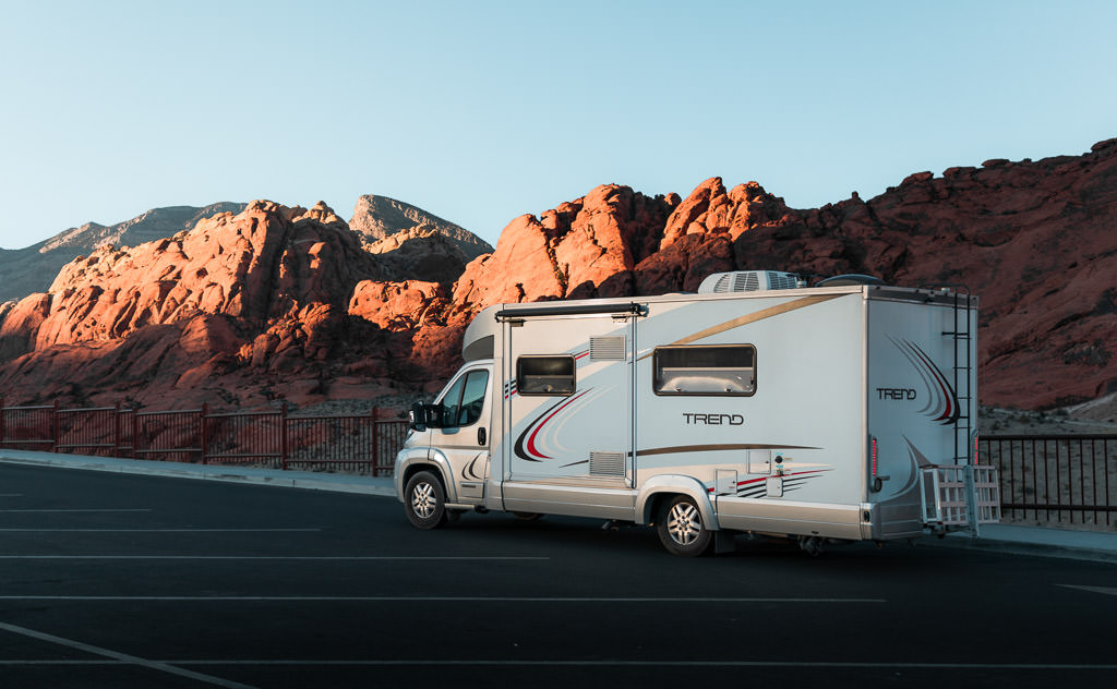 Winnebago Trend in parking lot with Red Rock Canyon in the background.